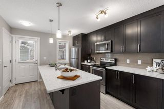 Photo 7: 1011 2400 Ravenswood View SE: Airdrie Row/Townhouse for sale : MLS®# A1121287