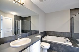 Photo 33: 566 River Heights Crescent: Cochrane Semi Detached for sale : MLS®# A1129968