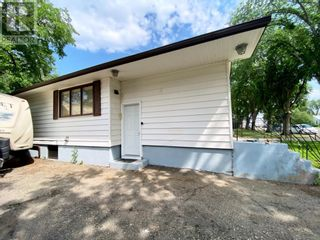 Photo 4: 415 3A Street W in Brooks: House for sale : MLS®# A1129371