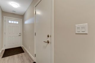 Photo 3: 303 428 Nolan Hill Drive NW in Calgary: Nolan Hill Row/Townhouse for sale : MLS®# A1141583