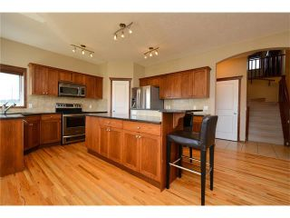 Photo 12: 112 WEST POINTE Manor: Cochrane House for sale : MLS®# C4116504