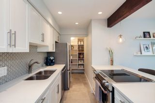 "Photo 9: E2 1100 W 6TH Avenue in Vancouver: Fairview VW Townhouse for sale in ""FAIRVIEW PLACE"" (Vancouver West)  : MLS®# R2189422"