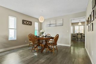 """Photo 7: 1306 FLYNN Crescent in Coquitlam: River Springs House for sale in """"River Springs"""" : MLS®# R2588177"""
