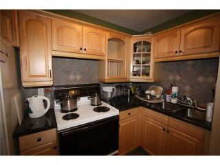 Photo 2: # 605 - 13104 Elbow Drive SW in Calgary: Canyon Meadows Stacked Townhouse for sale : MLS®# C3628442