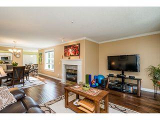 "Photo 6: 228 13880 70 Avenue in Surrey: East Newton Condo for sale in ""Chelsea Gardens"" : MLS®# R2563447"