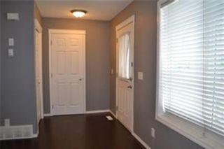 Photo 2: 92 Panamount Drive NW in Calgary: Panorama Hills Row/Townhouse for sale : MLS®# A1122234