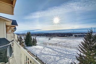 Photo 24: 19 117 Rockyledge View NW in Calgary: Rocky Ridge Row/Townhouse for sale : MLS®# A1061525