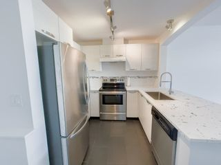 """Photo 5: 405 7478 BYRNEPARK Walk in Burnaby: South Slope Condo for sale in """"GREEN"""" (Burnaby South)  : MLS®# R2615130"""