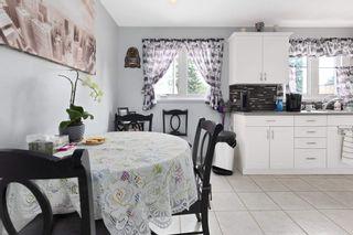 Photo 11: 10410 LAUDER Avenue in Edmonton: Zone 01 Attached Home for sale : MLS®# E4256925