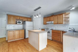 Photo 13: 7854 Springbank Way SW in Calgary: Springbank Hill Detached for sale : MLS®# A1142392