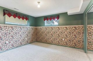 Photo 18: 51 SANDRINGHAM Way NW in Calgary: Sandstone Valley House for sale