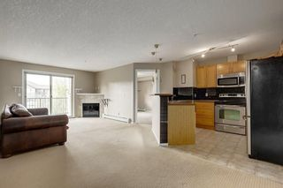Photo 4: 2308 8 BRIDLECREST Drive SW in Calgary: Bridlewood Condo for sale