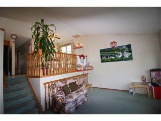 Photo 2: 228 ERIN MEADOW Close SE in Calgary: Erin Woods House for sale : MLS®# C4069091