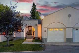 Photo 2: 10 Sandarac Circle NW in Calgary: Sandstone Valley Row/Townhouse for sale : MLS®# A1145487