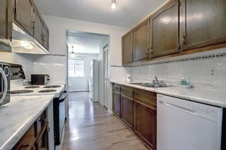 Photo 11: 104 210 86 Avenue SE in Calgary: Acadia Row/Townhouse for sale : MLS®# A1148130