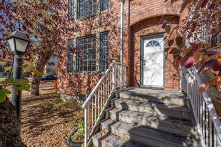 Main Photo: 3338 19 Avenue SW in Calgary: Killarney/Glengarry Row/Townhouse for sale : MLS®# A1155519