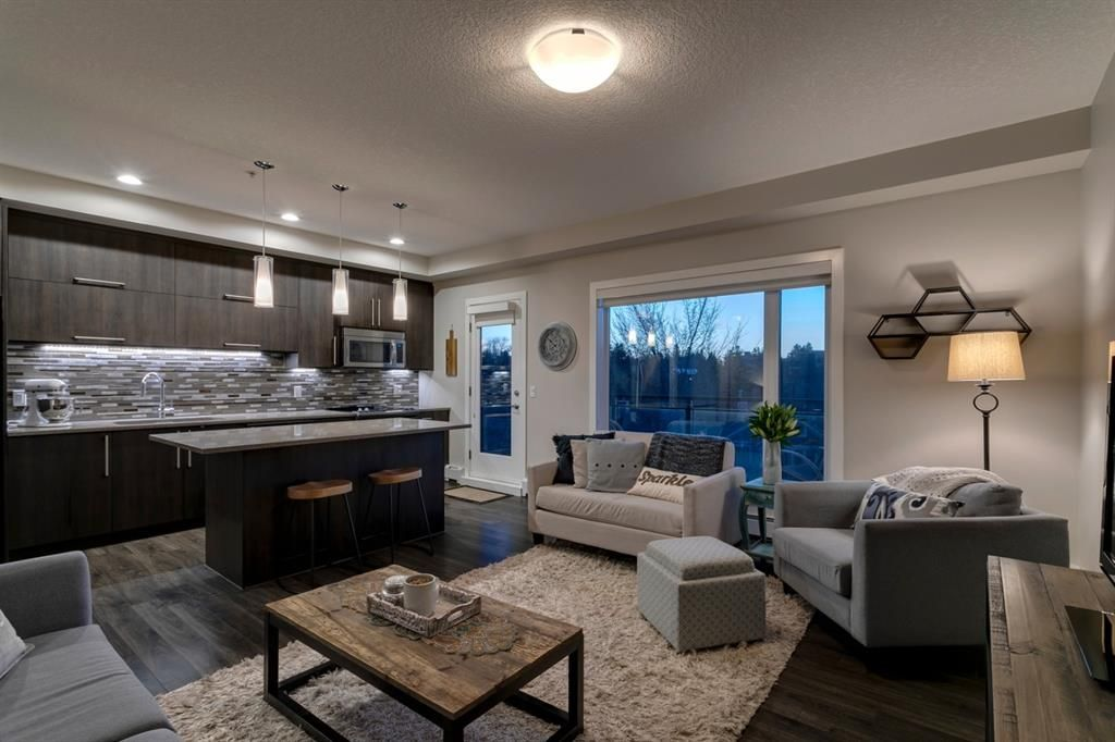 Main Photo: 405 93 34 Avenue SW in Calgary: Parkhill Apartment for sale : MLS®# A1095542