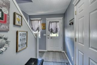 Photo 4: 132 Stonemere Place: Chestermere Row/Townhouse for sale : MLS®# A1108633