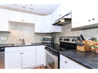 Photo 4: 138 ERIN RIDGE Road SE in Calgary: Erin Woods House for sale : MLS®# C4085060
