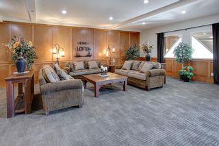 Photo 33: 306 77 George Fox Trail: Cochrane Apartment for sale : MLS®# A1139159