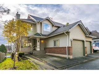 """Photo 1: 232 13900 HYLAND Road in Surrey: East Newton Townhouse for sale in """"Hyland Grove"""" : MLS®# R2519167"""