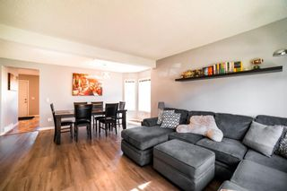 Photo 3: 113 Bedford Manor NE in Calgary: Beddington Heights Row/Townhouse for sale : MLS®# A1095621