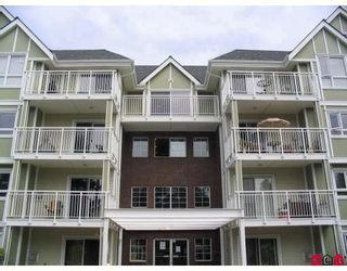 """Photo 1: 204 20189 54TH Avenue in Langley: Langley City Condo for sale in """"CATALINA GARDENS"""" : MLS®# F2818560"""