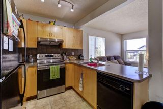 Photo 3: 388 Panatella Boulevard NW in Calgary: Panorama Hills Row/Townhouse for sale : MLS®# A1114400