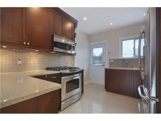 Photo 3: 4847 HENRY Street in Vancouver: Knight House for sale (Vancouver East)  : MLS®# V996847