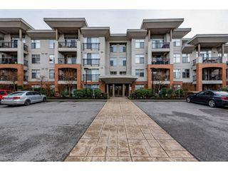 """Photo 1: 406 33545 RAINBOW Avenue in Abbotsford: Central Abbotsford Condo for sale in """"Tempo"""" : MLS®# R2527178"""