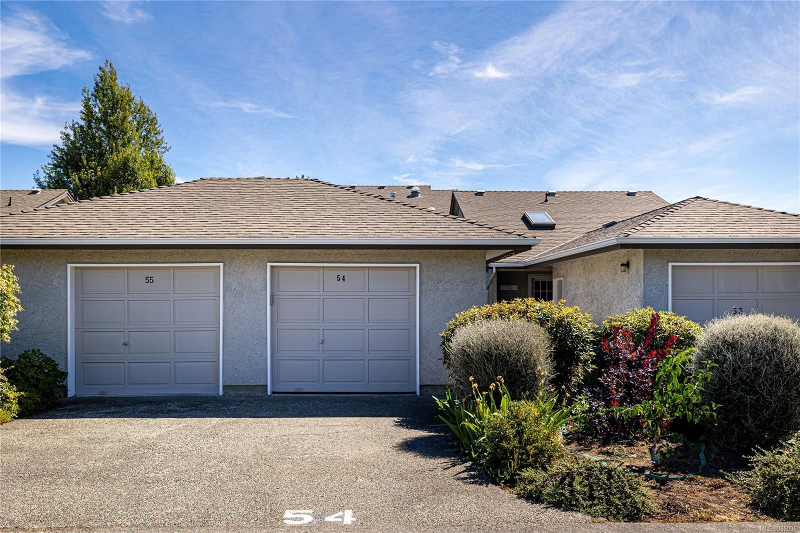 Townhome with detached garage plus extra parking spot in front of the garage and....