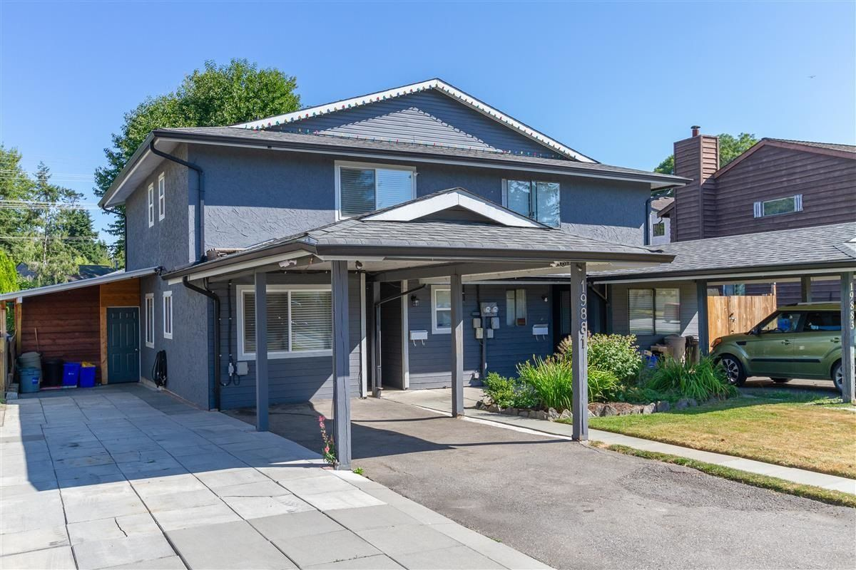 Main Photo: 19881 53 Avenue in Langley: Langley City 1/2 Duplex for sale : MLS®# R2607336