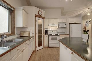 Photo 5: 13 Strathearn Gardens SW in Calgary: Strathcona Park Semi Detached for sale : MLS®# A1114770