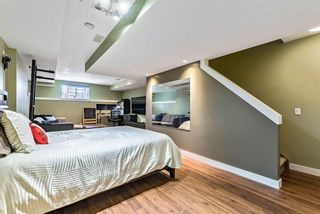 Photo 18: 1562 93 Street SW in Calgary: Aspen Woods Row/Townhouse for sale : MLS®# A1085332