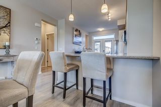 Photo 9: 100 Legacy Main Street SE in Calgary: Legacy Row/Townhouse for sale : MLS®# A1095155