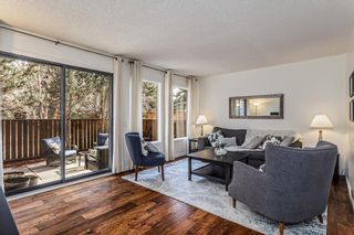 Main Photo: 122 Point Drive NW in Calgary: Point McKay Row/Townhouse for sale : MLS®# A1089373
