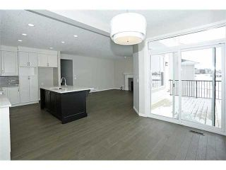 Photo 6: 78 AUBURN SPRINGS Park SE in Calgary: Auburn Bay Residential Detached Single Family for sale : MLS®# C3652537