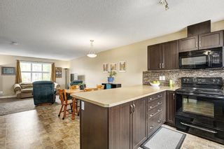 Photo 10: 94 SUNSET Road: Cochrane House for sale : MLS®# C4147363