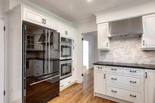 Photo 19: 7311 11 Street SW in Calgary: Kelvin Grove Detached for sale : MLS®# A1049038