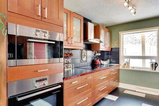 Photo 12: 49 MEADOWVIEW RD SW in Calgary: Meadowlark Park House for sale : MLS®# C4104032