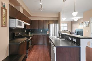 "Photo 9: 37 7518 138 Street in Surrey: East Newton Townhouse for sale in ""Greyhawk"" : MLS®# R2332671"