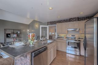"""Photo 7: 242 WATERLEIGH Drive in Vancouver: Marpole Townhouse for sale in """"LANGARA SPRINGS"""" (Vancouver West)  : MLS®# R2344704"""