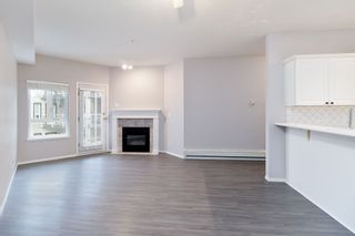 "Photo 3: 311 8142 120A Street in Surrey: Queen Mary Park Surrey Condo for sale in ""STERLING COURT"" : MLS®# R2434284"