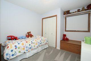 Photo 20: 306 WEST TERRACE Place: Cochrane House for sale : MLS®# C4117766