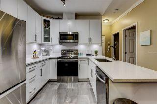 "Photo 2: 108 1591 BOOTH Avenue in Coquitlam: Maillardville Condo for sale in ""LE LAURENTIEN"" : MLS®# R2536606"