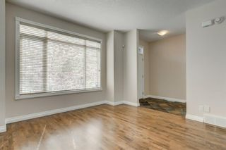 Photo 1: 4111 Garrison Boulevard SW in Calgary: Garrison Woods Row/Townhouse for sale : MLS®# A1108505