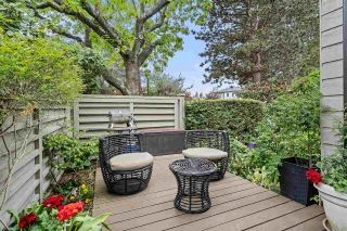 """Photo 1: 2199 MCMULLEN Avenue in Vancouver: Quilchena Townhouse for sale in """"ARBUTUS VILLAGE"""" (Vancouver West)  : MLS®# R2586427"""