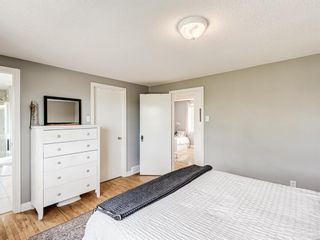 Photo 21: 63 Amiens Crescent in Calgary: Garrison Woods Semi Detached for sale : MLS®# A1098899
