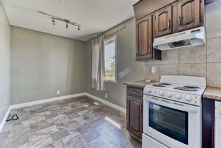 Photo 6: 218 Storybook Terrace NW in Calgary: Ranchlands Row/Townhouse for sale : MLS®# A1126980