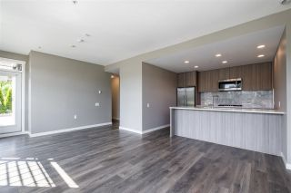 """Photo 7: 100 3289 RIVERWALK Avenue in Vancouver: South Marine Condo for sale in """"R & R"""" (Vancouver East)  : MLS®# R2470251"""